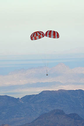 The Orion Crew Exploration Vehicle (CEV) Parachute Assembly System (CPAS) performed a successful airdrop test shortly after sunrise on July 27, 2010, at the US Army Yuma Proving Grounds in Arizona. The primary test objectives were 1) to measure the performance of a two drogue parachute cluster with one drogue skipping the second of two reefing stages and 2) to measure the performance of a two main parachute cluster with modified suspension line and riser lengths matching the Apollo configuration ratio. The test platform consisted of a pallet and weight tub and was extracted from a C-130 aircraft at 17,500 ft. The two drogue parachutes were deployed and performed nominally. The two main parachutes were deployed and also performed nominally but one parachute experienced a higher inflation load than expected during reefing stages. Both of the primary test objectives were successfully met. The test platform and all parachutes were successfully recovered and returned to the CPAS hangar in the city of Yuma. Steady descent under main chutes.