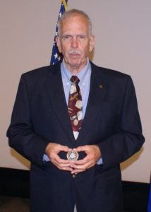 Clyde Lomax, S&K Global Solutions Logistics Management Anaylst with his award PBL coin.