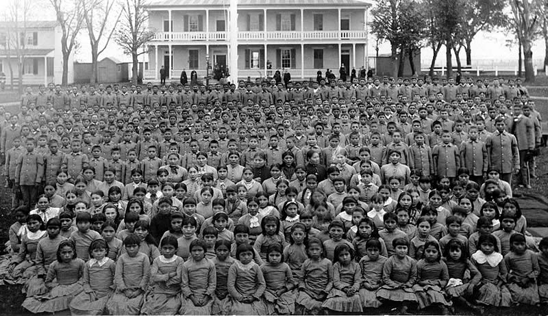 Student body assembled on the Carlisle Indian School Grounds. Read more: http://bit.ly/1KTUIuS