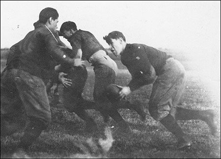 Carlisle player and football great Jim Thorpe (right) receives the ball. Hear the radio story: http://n.pr/1M4hkcb